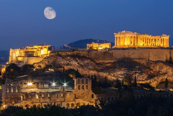 City of Athens at night with moon